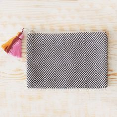 """Black and taupe colored hand brocaded clutch or cosmetic bag with multi-colored tassel.  Handwoven and sewn in Guatemala.7"""" high x 10"""" wide"""