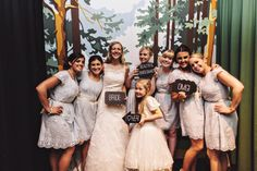 Image by Taylor Roades Photography - A Rustic Village Hall Wedding With A Blue And Gold Colour Scheme And Stag Graphic Across The Stationery With Bride In Bespoke Dress By Chic Dress And Groom In Brown Suit With Bridesmaids In Baby Blue Dresses With Broderie Anglaise Detail