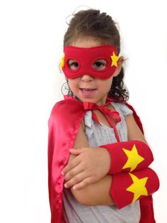 """Take 20% off the superhero costume sets with stars. Includes a 20"""" satin cape, felt cuffs and a felt mask with a fleece interior lining for comfort. #superherocostume #giftsforkids #giftideas #creativelearning Horse Costumes, Halloween Costumes, Red Superhero, Felt Mask, Bird Costume, Super Hero Costumes, Imaginative Play, Gifts For Girls, Playing Dress Up"""