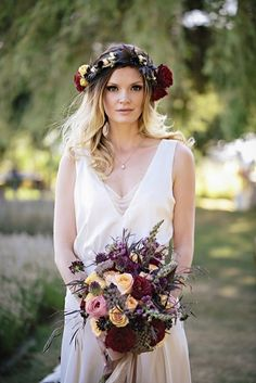 bride in sheath gown, floral headpiece with bouquet, photo by Jennifer Ballard Photography