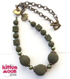 A lava stone and pearl necklace in forest green. Fresh in my Etsy shop today!