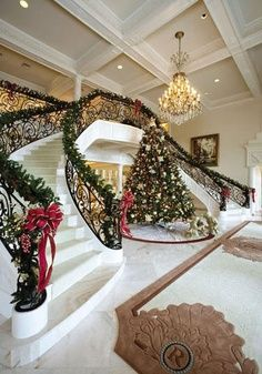 CHRISTMAS!!! Oh. My. Gosh. This is exactly the reason I want a curved staircase! This is my absolute dream!!
