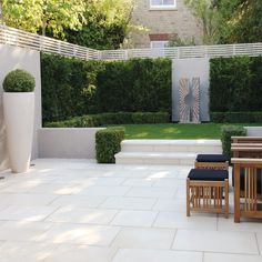 Garden; patio. Like the little hedges by the steps. More