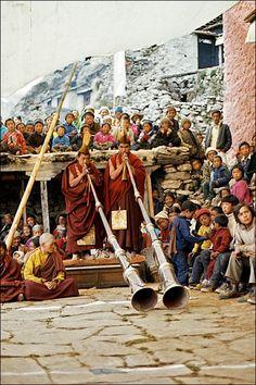 Monks blowing on Tibetan Horns in Nepal   Ton Lankreijer