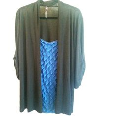 Andrea Black & Blue 2fer Cardigan/Cami Top 2X This Andrea Black & Blue 2fer Cardigan/Cami Top is a 2X in good used condition. There's an out layer of a soft/stretchy black cardigan/casual jacket and a front piece made to look like a blue ruffled spaghetti strap cardigan--but all in one garment. Easy dressing! Bust measures 24 inches across laying flat, measured from pit to pit. 32 inches long. Worn twice. ::: Bundle 3+ items from my closet and save 30% off when you use the app's Bundle…