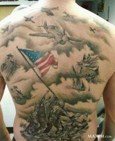 30. USMC DOWN ARM 31. FLAG RAISING ON IWO JIMA – MURAL ON BACK 32. COLORFUL FULL SLEEVE MURAL 33. DEVIL DOG WITH TWO M-16'S ON HIS BACK 34. BEAUTIFUL LARGE ANCHOR GLOBE AND KNIFE ON SIDE 35. FLAG ON SHOULDER WITH ANCHOR AND GLOBE 36. OLD SCHOOL DEVIL DOG STYLE TATTOO 37. EAGLE, GLOBE, AND ANCHOR ON BACK – PERFECT LETTERING 38. DRAGON WINGS COMING FROM CELTIC CROSS WITH USMC 39. DEVIL DOG DRILL INSTRUCTOR FLEXING HIS BICEP TAT