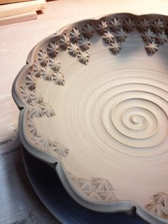 bowl stamping 5 Selena G- I like the stamping they did on the edge of the bowl and how they kind look like flowers.
