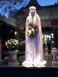 The undead bride in our window is not happy to be left from her altar.  #chicago #florist #Halloween  We sell new and used mannequins and forms at Mannequin Madness so you can create budget friendly window displays like this.