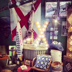 X marks the spot.  Vintage marquee lights and vintage signal flag at #teakandsoxy.