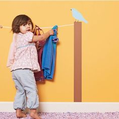 You or your toddler could pick out her outfit the night before and then hang it on the hooks of this painted clothesline saving the time in the morning if you need to get out of the house.