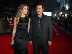 Johnny Depp, right, and Amber Heard pose for photographers upon arrival at the premiere of the film 'Black Mass,' as part of the London film festival in London, Sunday, Oct. 11, 2015. (  Joel Ryan, Invision/AP