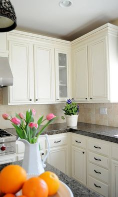"""myuncommonsliceofsuburbia.com  """"I love white kitchens, and consider them to be a classic. In my mind, you can never go wrong with a white kitchen and there is such an elegance about them.""""    I think the wall color may be """"bleeker beige"""""""
