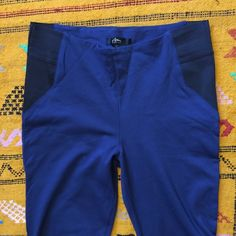 """Blue Stretch Skinnies Pre-loved in great shape. Stretchy dark blue skinnies with black accents on waist. Size EUR 40 (fits about US 8). Waist approximately 30"""" with 28"""" inseam. 68% viscose, 27% polyamide, 5% elastane Anu Pants Skinny"""