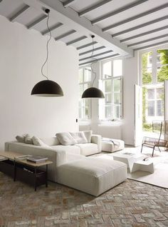 Living room, round lamps, white couches, rug, open windows, light: