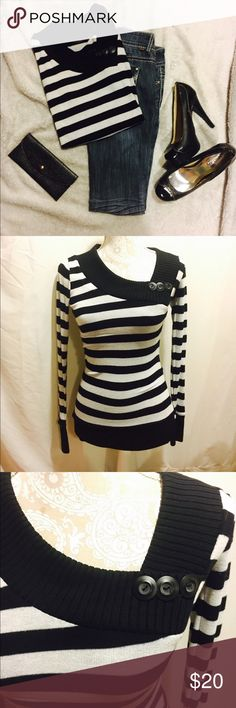 Black-and-white striped sweater In excellent condition black and white striped sweater with button detail at the neckline. 60% cotton 35% rayon 5% spandex Poof! Sweaters Crew & Scoop Necks