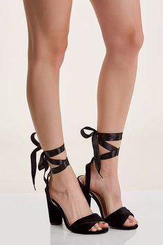Flirty open toe block heels with chic velour finish. Contrast lace up ribbon ties at ankle for added detail.