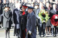 Prince William and Prince Harry salute after laying their wreaths at the Cenotaph
