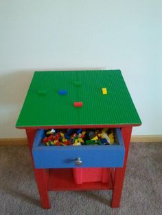 Homemade Lego Table.  Old end table, sanded and repainted.  Lego plates added to the top with Gorilla glue.