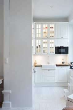 white ikea kitchen - a little like what our kitchen will look like from front door to kitchen at back of house