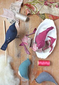 hand stitched songbirds on my worktable . revisiting my songbird pattern Fabric Animals, Fabric Birds, Fabric Scraps, Felt Animals, Textile Sculpture, Soft Sculpture, Ann Wood, Needle Felting Tutorials, Wood Bird