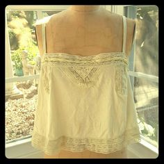 Urban Outfitters Pale Yellow Crop Top Soft, easy and cute, this UO crop top will not disappoint. Has lace details on top and bottom with added detail at the front top. Has adjustable straps. Urban Outfitters Tops Crop Tops