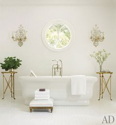 Suzanne Kasler  The master bath's tub and fittings are by Waterworks; the bronze-doré tables, found at a French flea market, once graced the Four Seasons Hotel George V Paris.