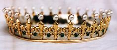 """Stylized after the painting """"The Accolade"""", this Viscount Coronet of Fleur de lis is adorned with pearls and green agates, It is made of German silver and brass. It weighs in at only 9 ounces. Circa 1540"""