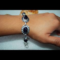 """Blue Goldstone Statement Bracelet 7 1/4""""-7 3/4"""" Blue Goldstone bracelet.Lenght:7 1/4""""-7 3/4"""",stone size:10x14mm.Set on 925 silver,stampedPlease note that the photos are enlarge slightly for your convenience so make sure to notice the actual measurements of the item on the """"product description"""" as it maybe smaller than the representing photo. Colors of the stone also may be slightly vary than the pictures due to light.These are all handmade items in my closet so please do not expect…"""