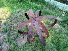 Rusty barrel hoops and spheres in the garden | Flea Market Gardening