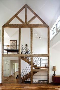 Staircase framed by lovely timber work.  www.methodstudio.london