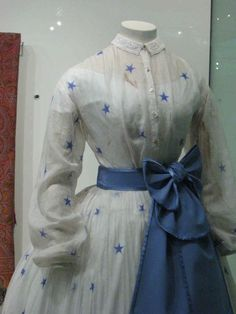 "1864 ""sheer"" dress with low lining. Close up of the bodice."