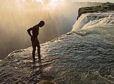 Devils Pool at the top of Victoria Falls, Zambia.  During the fall and winter months the water is low enough to jump in an swim right up to the edge...and look straight down the 300ft falls!
