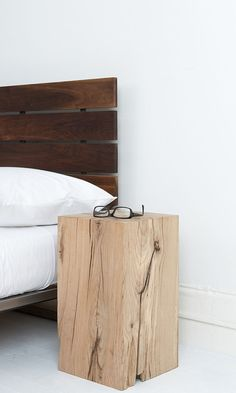 9 Creative Ideas For Adding A Nightstand To Your Bedroom // Add A Touch Of Nature --- Use tree stumps or a block of raw wood for a rustic yet modern nightstand.