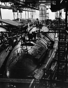 The Navy's Polaris Missile Launching Nuclear Powered Submarine, George Washington (SSBN-598), is readied for launching on 9 June 1959 by workmen at the General Dynamics Corporation's Electric Boat Division Shipyard at Groton, Connecticut. George Washington was the first U.S. Navy nuclear submarine designed to serve as an underwater launching platform for Polaris, the Navy's 1,200 mile ballistic missile. Photograph released on 21 May 1959.