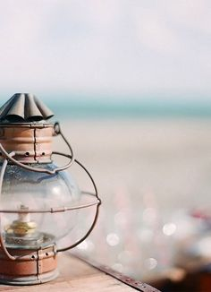 old lanterns on the table Cottages By The Sea, Beach Cottages, Coastal Style, Coastal Decor, Coastal Lighting, Coastal Cottage, Cap Ferret, Am Meer, Candle Lanterns