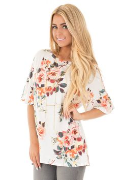 Lime Lush Boutique - Ivory Multi Floral Butterfly Sleeve Tunic Top, $36.99 (https://www.limelush.com/ivory-multi-floral-butterfly-sleeve-tunic-top/)
