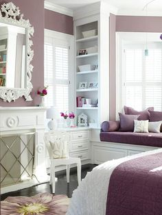 Love the combination of White and Purple.  Also, the book case and window seat are great ideas for a bedroom.
