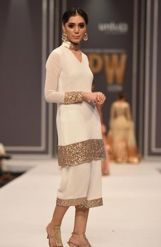 indian designer wear Hand crafted kundun white shirt and culottes (two piece set). Lining : Crepe de clean only Pakistani Fashion Party Wear, Indian Party Wear, Simple Pakistani Dresses, Pakistani Dress Design, Kurti Designs Party Wear, Kurta Designs, Lovely Dresses, Stylish Dresses, Stylish Dress Designs