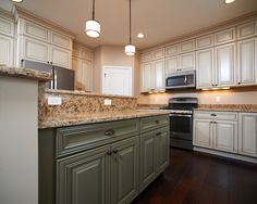 Wayne Homes Covington Kitchen  White Cabinets and Green Island