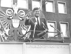 1963. Juin. Cologne. John F. Kennedy visits the Federal Republic of Germany. President John F. Kennedy is waving to an excited crowd of people in front of the city hall in Cologne, short after his arrival at Cologne-Bonn airport. The president was visiting the federal republic for four days