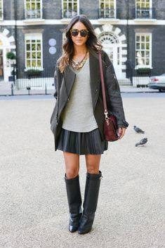 Wear your sexy leather pieces two ways: Givenchy boots and a black pleated skirt definitely added a fierce vibe.