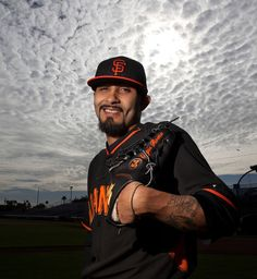 Picher Sergio Romo (54) poses for a photo as the San Francisco Giants hold spring training at Scottsdale Stadium in Scottsdale, Ariz., Sunday, Feb. 23, 2014. (Patrick Tehan/Bay Area News Group)