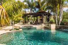 Mediterranean Swimming Pool with outdoor pizza oven, exterior stone floors, Fence, Trellis, Pathway, Pool with hot tub
