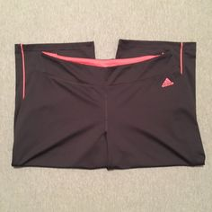 """ADIDAS Gray & Pink Workout Capris EUC ADIDAS charcoal gray, wide leg workout capris with pink accents. Size Large. Approximate 18.5"""" inseam. 94% polyester and 6% spandex. No rips, stains, or pilling; like new. (Disclaimer for allergy sufferers, this top comes from a cat lovers home.) Adidas Pants Track Pants & Joggers"""