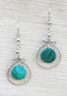 Trades of Hope - Made by artisans who live in the beautiful Urubamba Valley of Peru, famous for its Inca ruins and artistic talent.  The guerilla warfare and rural settings leave many women, abandoned by their husbands, with children to feed. Their handcrafts are helping to meet their basic needs of food, shelter and clothing.    Made in Peru - Natural chrysocolla stone 2""