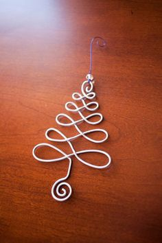 Items similar to Wire Christmas Ornament : Christmas Tree. Celtic Wire Tree Tree of Life Infinity Tree Christmas Tree Holiday Ornament Handmade Wire Art on Etsy Wire Ornaments, Handmade Ornaments, Handmade Wire, Handmade Jewelry, Etsy Handmade, Christmas Wall Art, Christmas Jewelry, Christmas Tree Ornaments, Christmas Diy