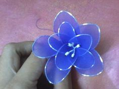 Here is how to assemble this flower.      Materials   	nylon fabric 	floral wire 	foral stamen 	pencil 	thread