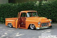Lowered orange 55 Chevy with suicide doors
