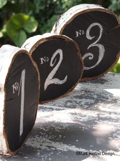 Rustic Wedding Table Numbers: wood slices + chalkboard paint. This would be fun for an outdoor reception in Tahoe South