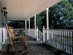 I love this porch. I own these rockers, so maybe one day I will be lucky enough sit in one on a porch like this...